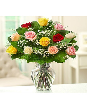 12 Premium assorted roses with baby breath and greenery in a glass vase