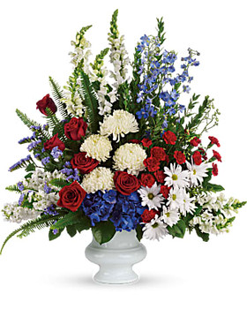 flowers such as red roses and carnations, white stock, snapdragons and chrysanthemums, blue hydrangea and delphinium,one sided