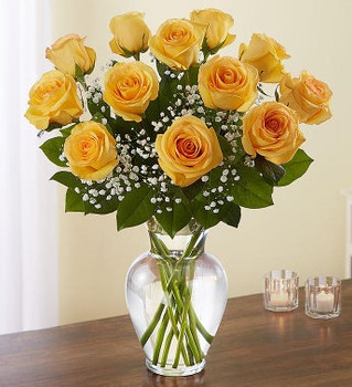 All-around arrangement with 12  long stem yellow roses; accented with baby's breath and assorted greenery