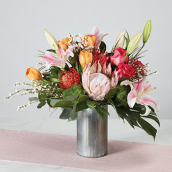 roses, pincushions and Stargazer lilies fill a galvanized waterproof vase