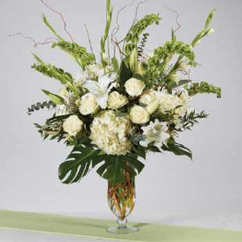 White Roses,Bells of Ireland, White Oriental Lilies, Gladiolas, and Hydrangeas accented with an array of greens