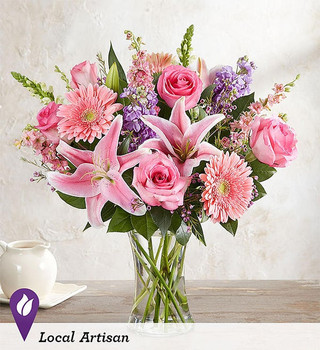 All-around arrangement with pink roses, Gerbera daisies, Oriental lilies, and larkspur, white snapdragons, and lavender stock