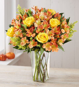 Our fresh fall bouquet is brimming with beauty and color. Vibrant, long-stem yellow roses pair with rich orange Peruvian lilies to make every birthday, anniversary, housewarming, or homecoming a little brighter.