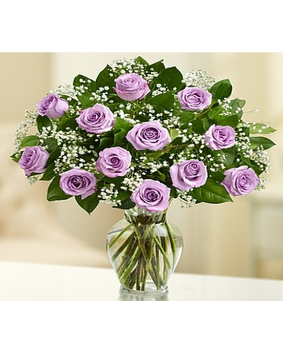 12  gorgeous long-stem purple roses, gathered in a classic vase