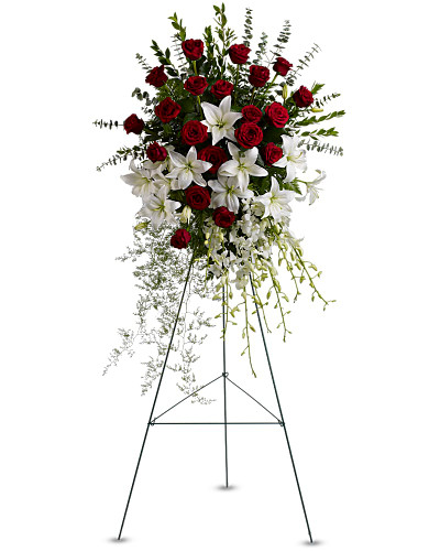 Red roses, white lilies and cascading white orchids are elegant funeral flowers fit to honor someone truly special.Red roses, white asiatic lilies and delicate dendrobium orchids are accented with myrtle, sprengeri fern, leatherleaf fern and spiral eucalyptus on a traditional wire funeral easel.