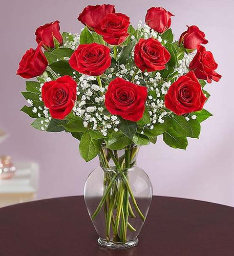 12  red radiant blooms are hand-delivered and ready to delight them for any romantic reason.