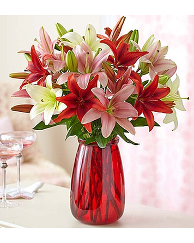 If lilies are her absolute favorite flower, there's no better bouquet for any occasion. Featuring vibrant pink, red and white blooms, it's a gift that lets them know you remembered.
