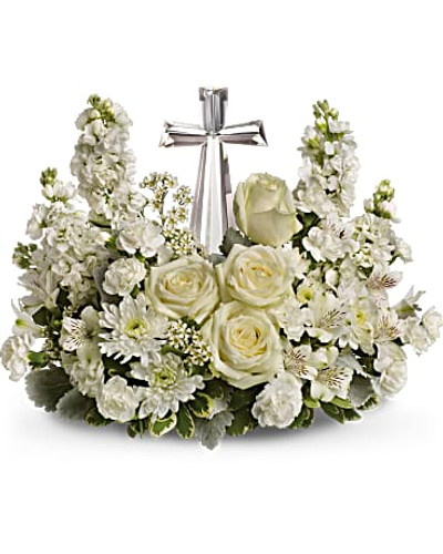 A fragrant mix of pure white blooms - including roses, alstroemeria, stock, carnations and waxflower - is accented with dusty miller and variegated pittosporum around an exclusive Crystal Cross keepsake.