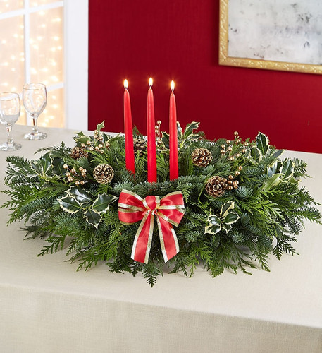 Grand Holiday Centerpiece is made from fresh noble fir and Western red cedar accented with pine cones, berry clusters, holly leaves, and an elegant  bow.