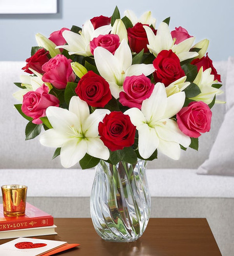Mixed bouquet of 9 hot pink roses, 9 red roses and 6 white Asiatic lilies