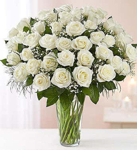 All-around arrangement with  48 long stem white roses; accented with baby's breath and assorted greenery