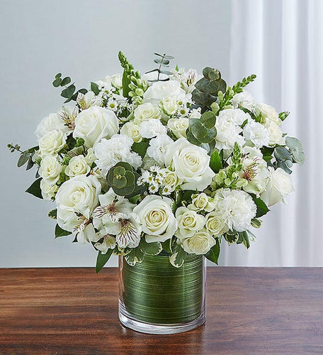 Arrangement of white roses, spray roses, snapdragons, alstroemeria, carnations, mini carnations and monte casino; accented with fresh greenery