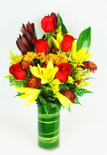 Red roses, yellow lilies, fall daisies, safari sunset, variegated tea leave