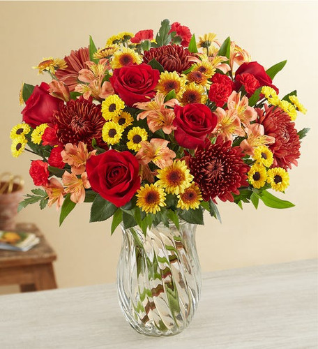 Bouquet of 12 long-stem red roses,  orange Asiatic lilies and  orange Peruvian lilies