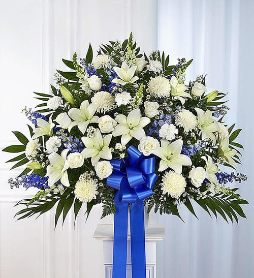 Maybe they loved the color blue…or maybe they enjoyed the calmness of the ocean under a cloudless sky. Our majestic blue and white standing basket arrangement will help honor their memory in a unique and meaningful way. Artistically designed by our expert florists with rich blue and pristine white blooms, this floral tribute is a heartfelt expression of your deepest sympathies.