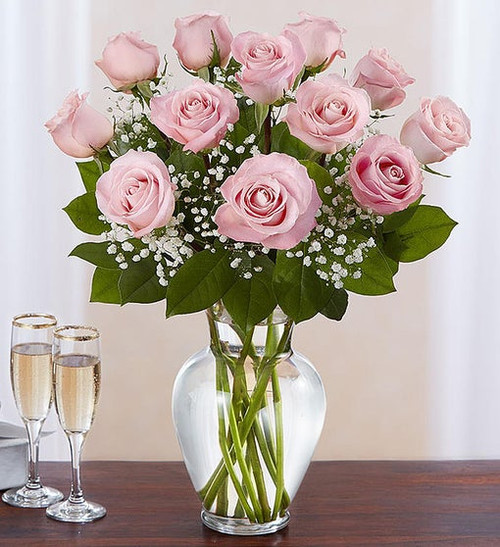 All-around arrangement with 12  long stem pink roses; accented with baby's breath and assorted greenery