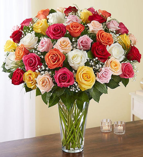 Our rainbow of long stem roses is the ultimate surprise for letting someone know how you feel. Four dozen blooms in a stunning array of colors are artistically arranged by our expert florists inside an elegant glass vase and personally hand-delivered to help you beautifully express what's in your heart.