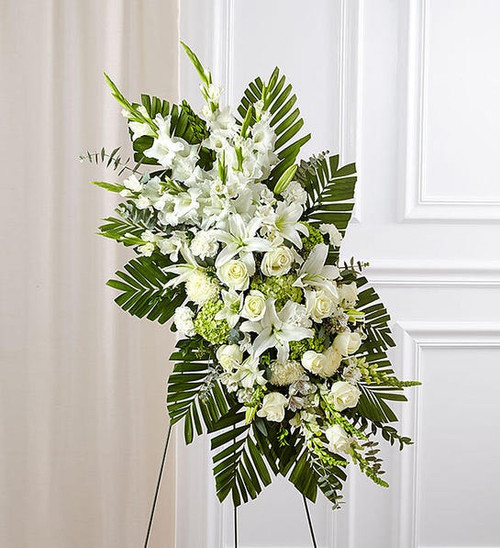 Arrangement of roses, gladiola, emerald, Oriental lilies, mini hydrangeas, carnations, mums, snapdragons, alstroemeria, monte casino, myrtle, spiral and seeded eucalyptus and salal