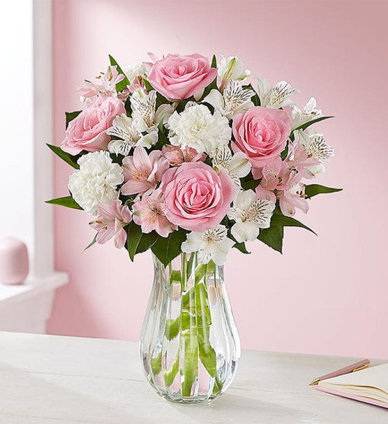 Bouquet of pink roses, white carnations, and pink & white alstroemeria