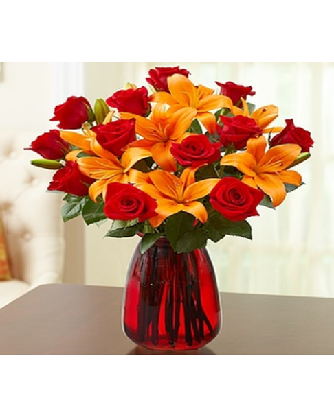 one dozen long-stem red roses and six vibrant orange Asiatic lilies