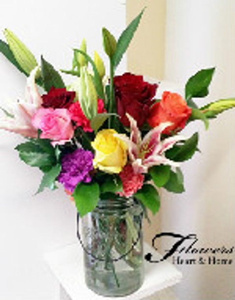 One of our most popular designs, it reflects the colors of spring and the happiness of Carnival, a truly pick me up, as we put the varieties of fresh flowers in hand and the varieties of colors, carnations, daises, lilies, roses, tulips, soledego is just a sample, all in a glass jar.