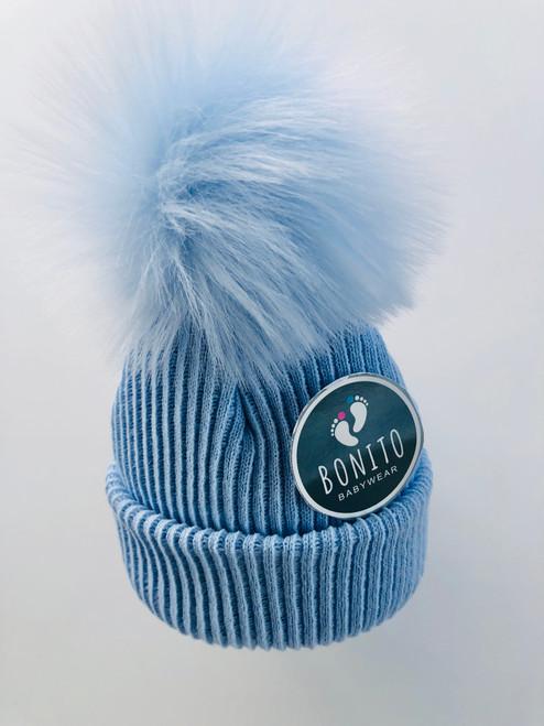 Fur pom-pom hat