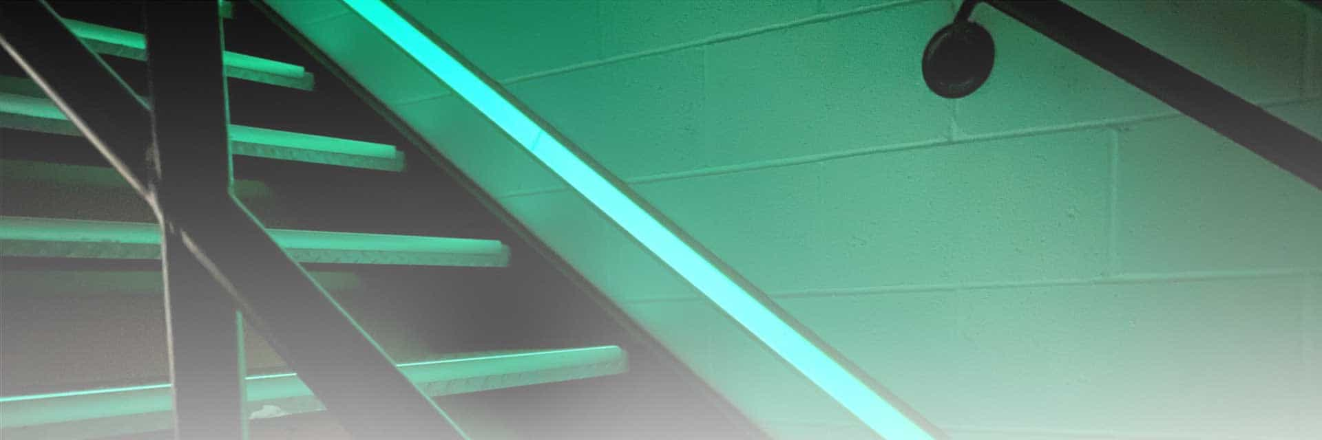ecoglo banner image: stairwell with photoluminescent pathmarking tape
