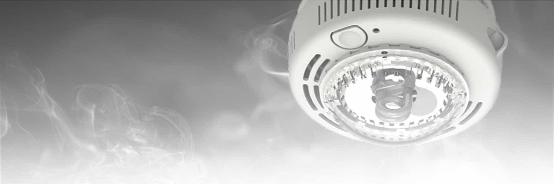 Smoke Control banner image. Smoke alarm on ceiling with white smoke rising towards it.