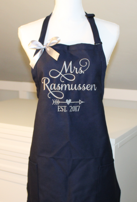 Mrs. Apron in Grace Font with arrow with heart.