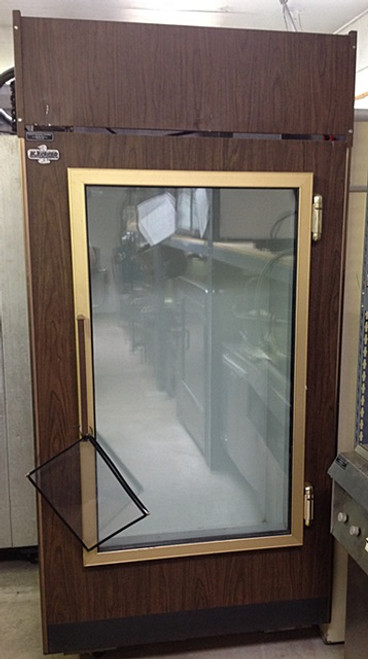 "Used-Leer ice freezer, single glass door merchandiser, wood grain exterior, white interior, 39""W x 76""H x 31""D(+2"" for door handle), 115 volts"