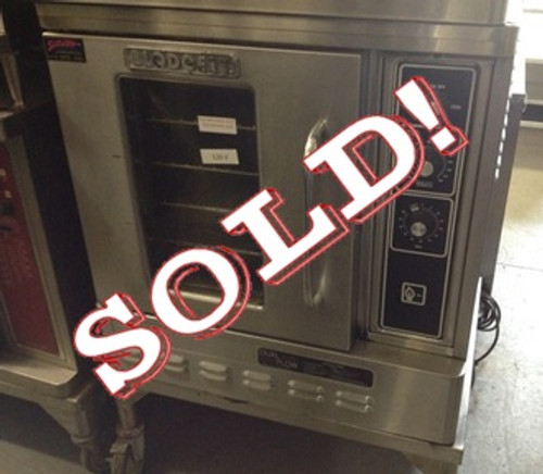 "USED-Blodgett Convection Oven, natural gas, half-size, single-deck, capacity (5) 13"" x 18"" pans, 1-speed fan, interior light, single door with dual pane thermal glass, stainless steel front, sides & top, 31""W x 27""D x 36""H, 27,500 BTU, 115 volts, CE, ETL, NSF"