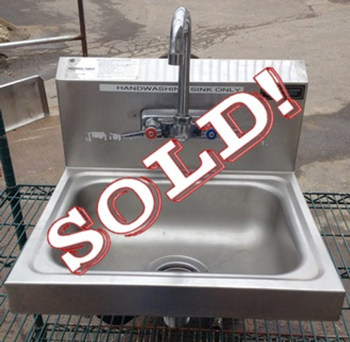 "USED-Advanced Tabco Hand Sink, wall model, 14""W x 10"" front-to-back x 6"" deep bowl, overall dimensions 17""W x 16"" front-to-back x 8""D, 18 gauge 304 series stainless steel, splash mounted gooseneck faucet, basket drain, wall bracket, NSF, cCSAus"