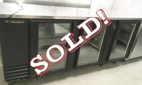 """TBB-4G Back Bar Cooler, three-section, 37"""" high, (152) 6-packs or (4) keg capacity, (6) shelves, condensing unit on left, stainless steel top, galvanized interior with stainless steel floor, black vinyl exterior, (3) glass doors with locks, interior light, 1/2 HP, 115v/60/1, 10.7 amps, 7' cord, NEMA 5-15P, MADE IN USA. NBm."""