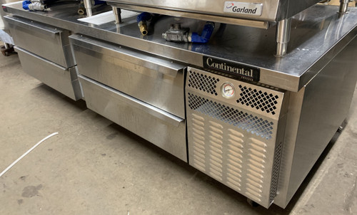 "USED CONTINENTAL Freezer Griddle Stand, two-section, (4) drawers, two drawers accommodates (1) 12"" x 20"" x 6"" & (1) 6"" x 20"" x 6"", two drawers accommodates (2) 12"" x 20"" x 6"", stainless steel top with drip guard marine edge, stainless steel exterior & interior, self-contained refrigeration, 1/3 HP, 10' cord, cETLus, NSF, Made in USA"
