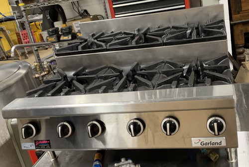"""USED GARLAND Step-Up Hotplate,  NAT gas, 36"""", countertop, (3) 30,000 BTU open burners, (3) 30,000 BTU step-up open burners, manual controls, pilot lights, stainless steel front, sides and back, 3-1/2"""" front rail, 4"""" high adjustable legs, 180,000 BTU, CSA, NSF"""