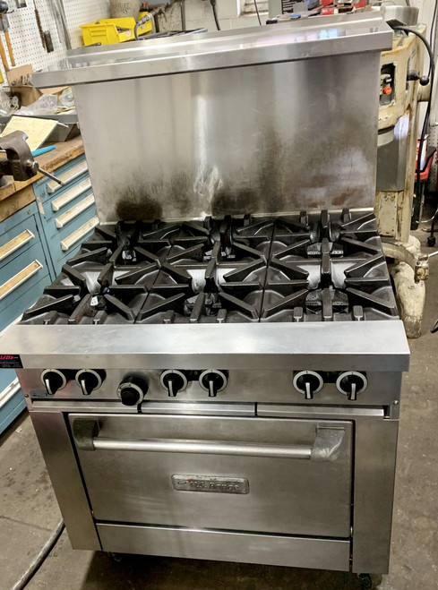 """USED US RANGE Restaurant Range, natural gas, 36"""", (6) 32,000 BTU open burners, cast iron top & ring grates, standard oven, (1) oven rack, 3 position rack guides, stainless steel front, sides, plate rail, 2-piece back guard & shelf, 6"""" stainless steel legs, adjustable feet, 230,000 BTU, CSA Flame, CSA Star, cCSAus, NSF"""