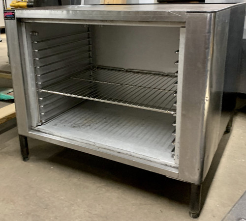 USED CONVECTION OVEN STAND WITH RACKS.
