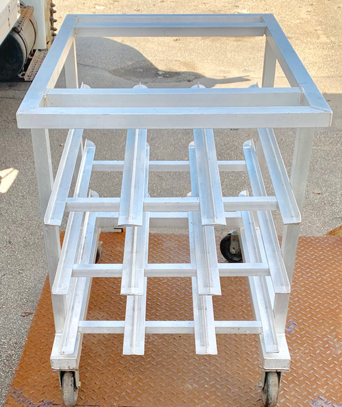 """Can Storage Rack, mobile, counter height, aluminum construction with no top, sloped glides, accommodates (54) #10 cans or (72) #5 cans, (2) swivel/brake & (2) rigid 5"""" platform casters, NSF, Made in USA"""
