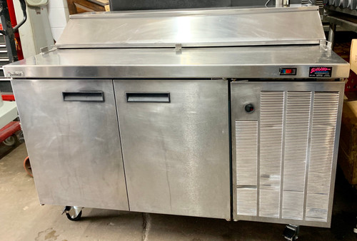"used Delfield F18RC55 55"" 2 door sandwich unit with top cold rail, 16 pan capacity, 38-42 F degrees, 115V."