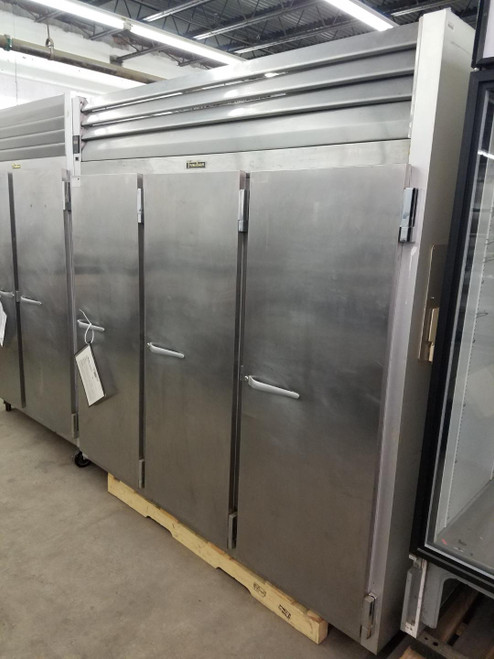 "USED TRAULSEN Freezer, Reach-in, three-section, 69.1 cu. ft., self-contained refrigeration with microprocessor control, stainless steel front & full height solid doors, anodized aluminum sides & interior, 6"" high casters, 1PH/115V. NSF."