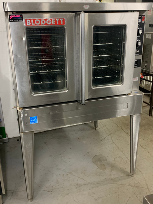 "USED Convection Oven, electric (208v/3phase), single deck, standard depth, capacity (5) 18"" x 26"" pans, stainless steel doors, dual pane thermal glass windows, stainless steel racks and rack positions, tubular black soft touch door handle, solid state manual controls, cooling fan, porcelain cavity, lights, full angle iron frame, stainless steel construction, 25"" stainless steel legs, 1/2 hp blower, cETL, NSF"
