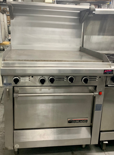 "USED Heavy Duty Range, natural gas, 34"", griddle, manual controls, standard oven, electric ignition & flame fail all burners, stainless steel front & sides, 6"" legs, 139,000 BTU, CE, CSA Flame, CSA Star, NSF"