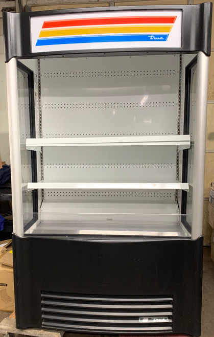 "USED TRUE Vertical Air Curtain Merchandiser, 48""W, 80-5/8""H, (4) white PVC-coated shelves, LED interior lighting, vinyl exterior, white aluminum interior with stainless steel floor/deck pans, leg levelers, 1-1/2 HP, 208-230v/60/1-ph, 12.0 amps, NEMA 6-15P, cULus, CE, UL EPH Classified, Made in USA"
