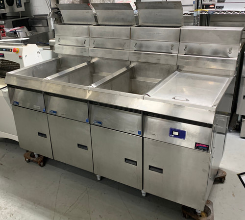 USED Pitco F14S-V bank of three fryers with built in filtrator. LP gas, 120V.