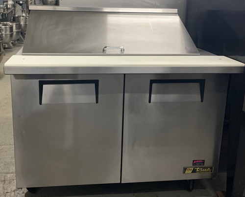 "USED Mega Top Sandwich/Salad Unit, (18) 1/6 size (4""D) poly pans, stainless steel insulated cover, 8-7/8""D cutting board, (2) full doors, (4) PVC coated adjustable wire shelves, stainless steel top, front, sides, aluminum back, aluminum interior with stainless steel floor, 5"" castors, R290 Hydrocarbon refrigerant, 1/3 HP, 115v/60/1-ph, 5.8 amps, NEMA 5-15P, cULus, UL EPH Classified, CE, Made in USA"