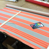 "1.8 Yard Piece of Indoor / Outdoor Upholstery Fabric | Orange / Gray Striped | 54"" Wide"