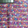 """Purple Shadow Stripe floral silky print   pink, orange, white and teal flowers   45 """" wide   100% polyester"""