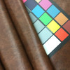 """Mottled Brown Felt-Backed Faux Leather Vinyl Fabric 