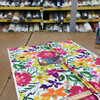 """Okeefe in Roseus   Watercolor Floral in Pink / Orange / Yellow / Green   Upholstery / Drapery Fabric   Covington   54"""" Wide   By the Yard"""