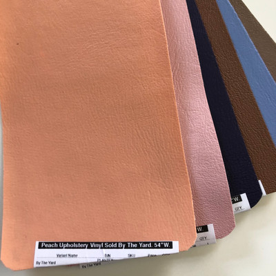 """Peach Upholstery Vinyl Sold By The Yard.   54""""W."""